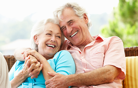 White elderly couple laughing together